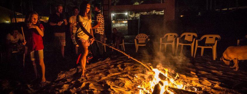Toasting Marsh Mellows at beach bon fire