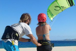 Kiteboarding Instructor teaching student how to fly a kite